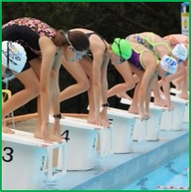 Students diving off a diving board