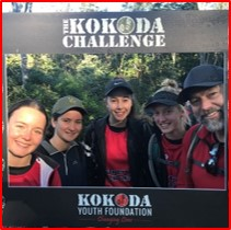 Students standing with a Kokoda Challenge sign